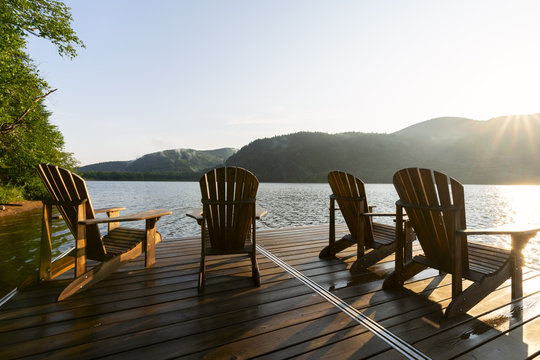 Adirondack deck chairs on lake dock