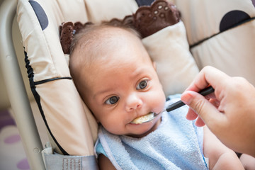 Baby blue eyed boy eating baby baby - In baby stroller