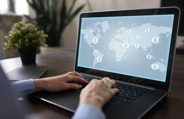 World map with bitcoin icons on virtual screen. Crypto currency. Blockchain technology. Internet payments.