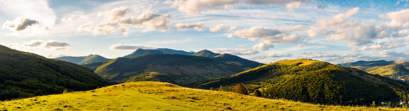 panorama of mountainous countryside. beautiful evening weather with cloudy sky over the ridge