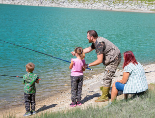 happy family fishing together