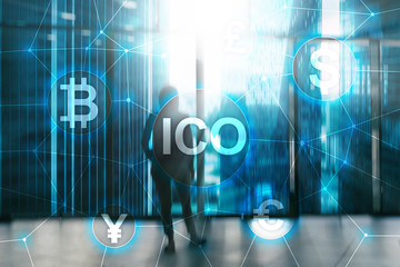 ICO - Initial coin offering, Blockchain and cryptocurrency concept on blurred business building background.