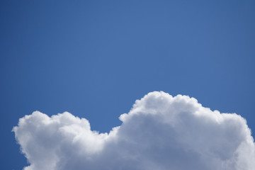 Fragment of a fluffy clouds in the blue sky with cpy space