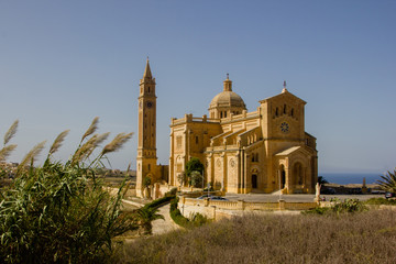 The famous and historical cathedral Ta Pinu on the Maltese island Gozo near Gharb with blue sky