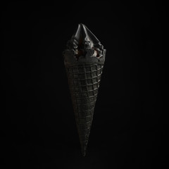 black ice cream on a black background.Style and summer mood