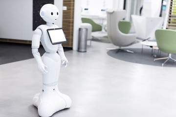 Welcoming electronic cyborg robot with white tab screen