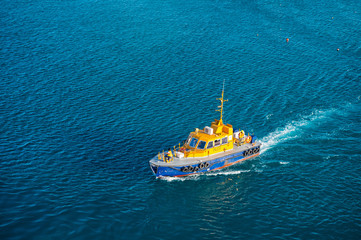 Bridgetown, Barbados - December 12, 2015: pilot rescue boat float in blue sea. Maritime pilots transport and transportation for people rescue. Orange rescue boat on water.Boat flows to rescue people