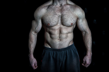 Perfect look. Torso with six packs looks attractive on black background. Muscular torso with huge muscles result of exhausting trainings and proper nutrition. Achieve muscular torso tips