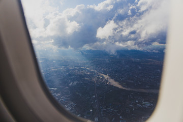 aerial view of the city of London from airplane window seat