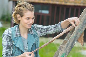 happy female gardener outside greenhouse