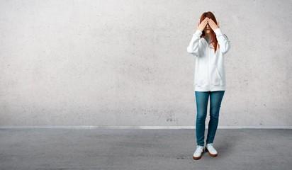Young redhead girl in an urban white sweatshirt wit