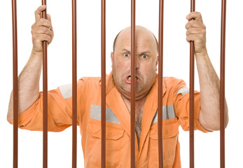A hardened criminal behind bars with an angry expression.