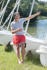 mature sailing professor giving lesson