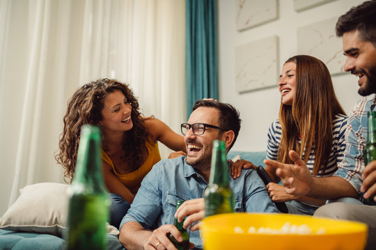 Portrait of group of friends having fun at home and enjoying together