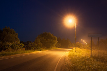street lights illuminate night road