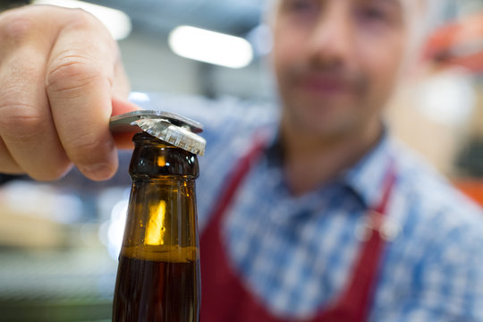 opening a beer bottle