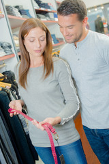 Couple shopping for a belt