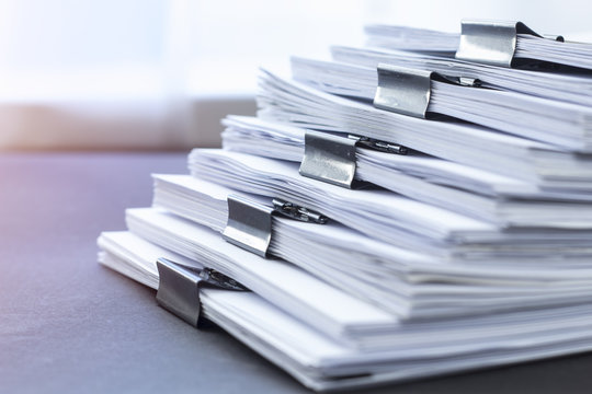 Paper office documentation. Financial reports.
