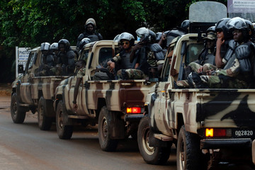 Riot police patrol the streets during a run-off presidential election in Bamako