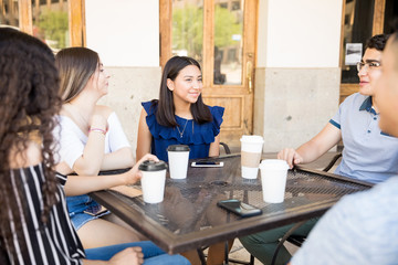 Group of friends meeting at coffee shop
