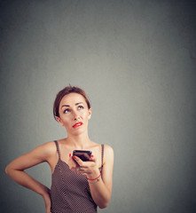 Annoyed woman speaking on phone and grimacing