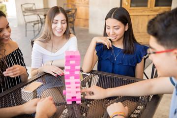 Group of teenagers playing jenga