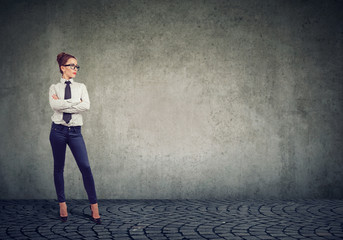 Attractive businesswoman standing confident with arms crossed