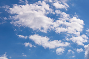 White fluffy clouds against a blue sky