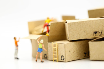 Miniature people : climbers team climbing on box of coins,Business travel concept.