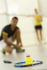 close up of shuttlecocks badminton racket