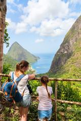 Fototapete - Family enjoying view of Piton mountains