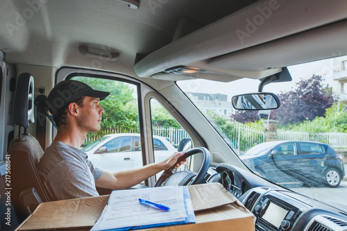 delivery transportation service job, driver man with package