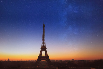 night in Paris with blue starry sky, beautiful romantic view of Eiffel Tower with stars, France