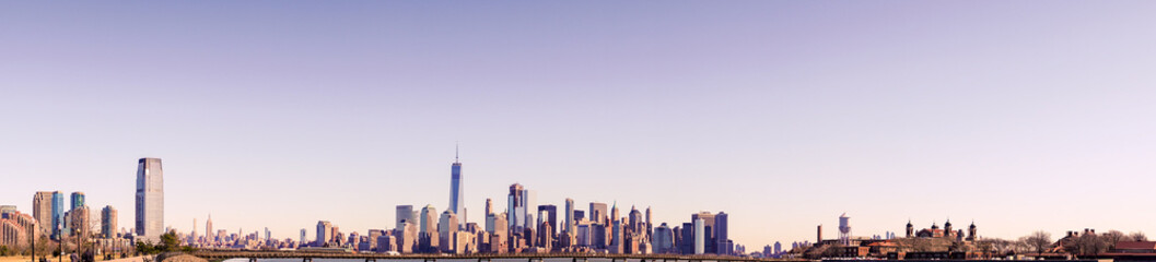 New York  City Skyline Panorama with colorful sky at sunset