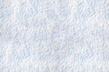 white snow texture on a Sunny day