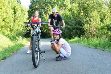 Family to bike on the field road for sport activity