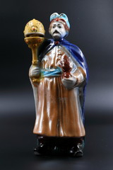 Figure of the dvolny grandee with a mace in a blue raincoat and with moustaches.