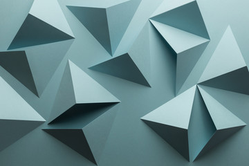 Composition with triangular shapes of paper, blue background