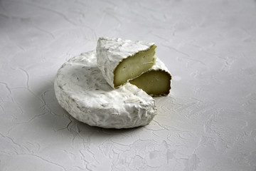 Ripe cut cheese camembert or brie brie on a cracked table