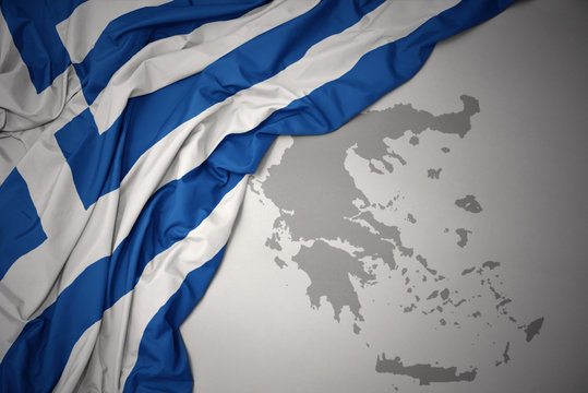 waving colorful national flag and map of greece.