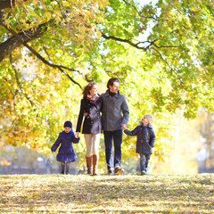 Family with children in autumn park