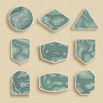 Set of nine empty topographic map travel emblems. Outdoor adventure emblems, badges and logo patches. Map pattern with mountain texture and grid