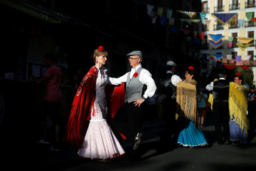 "People dressed in Madrid's traditional attire ""Chulapos"" attend the Feast of La Paloma Virgin in Madrid"