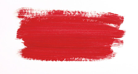 Red brush stroke isolated over white background