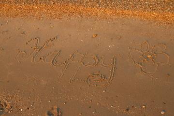 happy written on sand
