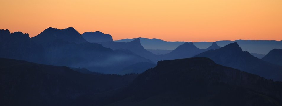 Mountain ranges at sunset. View from Mount Niesen.