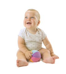 Adorable baby boy siting with colorful ball, looking up and laughing. Isolated on white background.