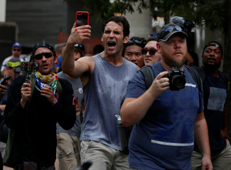 Counter-protesters shout near a white nationalist-led rally in Washington