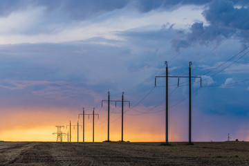 Rural landscape with high-voltage line on sunset Wall mural