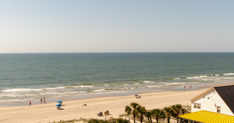 Surfside Beach with people and umbrellas in South Carolina